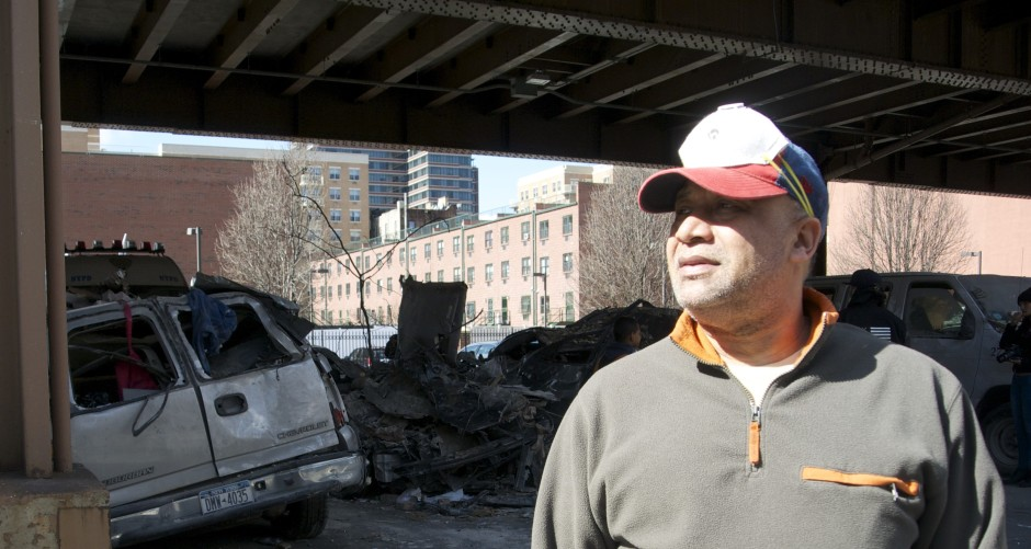 Local Francisco Bonivia stares at the damaged vehicles and talks about his friend who was killed in the blast. Photos by A.E. Sarver.