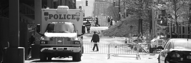 Firefighters and police officers work to continue to clear debris at the scene of the East Harlem explosion. Nearly four blocks surrounding the blast are taped off with police tape, forcing residents to find alternative routes to local businesses and their homes.