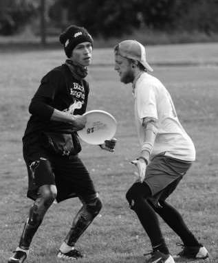 Senior Nick Geever attempts to pass the frisbee at a tournament in Rockford, Ill.