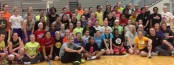 Women's basketball clinic participants pose for a photo with WNBA player Elena Delle Donne. Photo by Bethany Munroe.