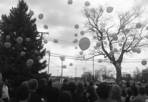Friends and family release balloons for Michael outside of Clancy-Gernon Funeral Home in Bourbonnais, just one of many sites where balloons were released. Photo by Taylor Provost.